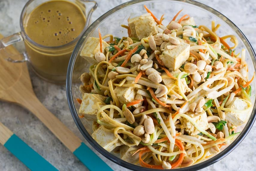 Low FODMAP Zoodles, Noodles & Sprouts Salad with peanut lime sauce alongside