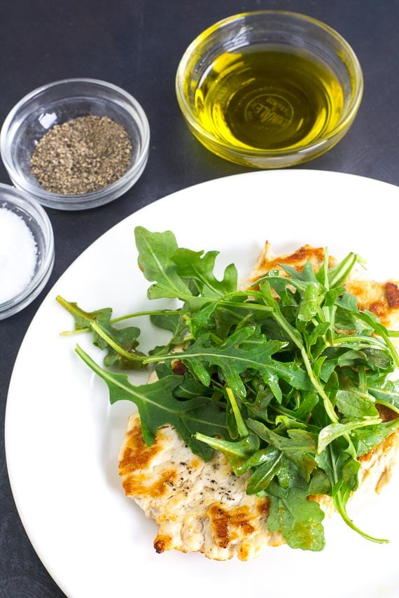 No FODMAP Chicken Paillard on white plate topped with no FODMAP arugula salad-2