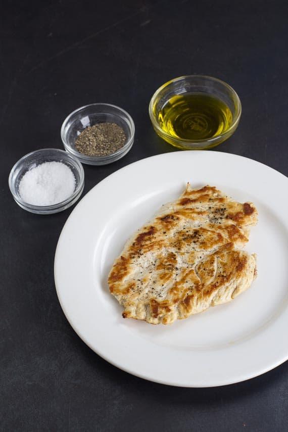 No FODMAP Chicken Paillard on white plate