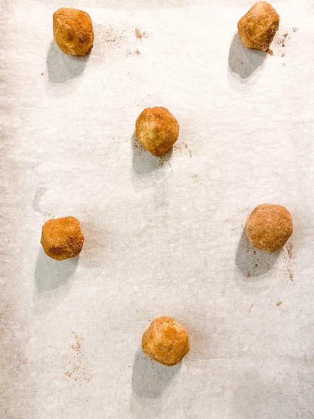 balls of dough spaced out on pan for low FODMAP Snickerdoodles