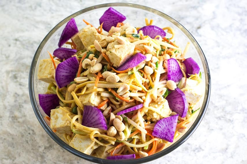 low FODMAP Zoodles & Noodles with purple daikon radish added in glass bowl
