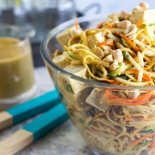 main image of Low FODMAP Zoodles, Noodles & Sprouts Salad in glass bowl