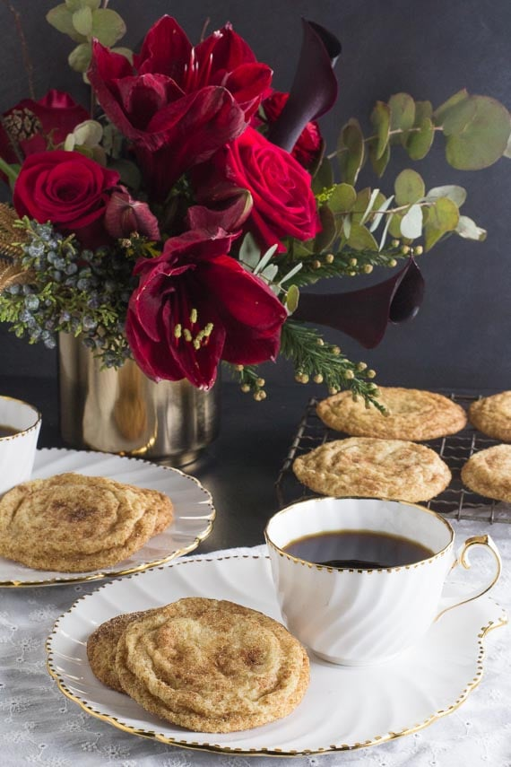 vertical image of Low FODMAP Snickerdoodles on white plate with cup of coffee alongside