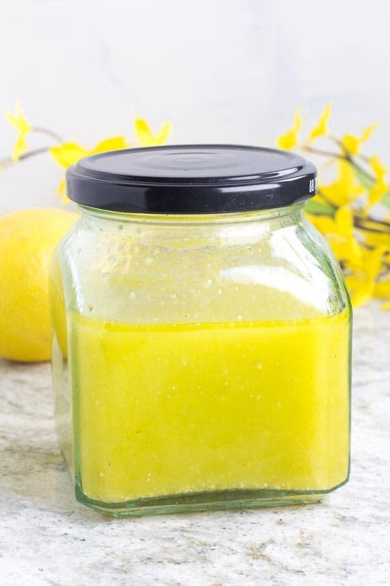 vertical low FODMAP Lemon Salad Dressing closeup in glass jar