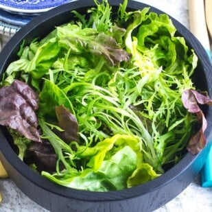 No FODMAP Leafy Green Salad in wooden bowl