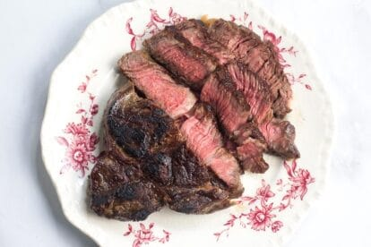 No FODMAP Steak on a decorative plate against white background