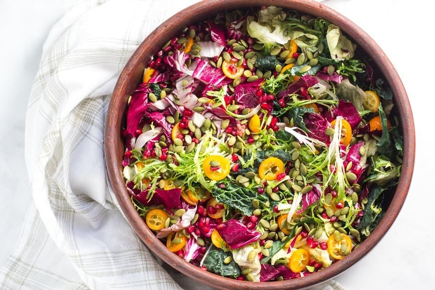 overhead Low FODMAP Greens with Kumquats and Pomegranate