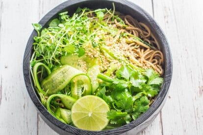 Cold soba noodle salad in ceramic bowl