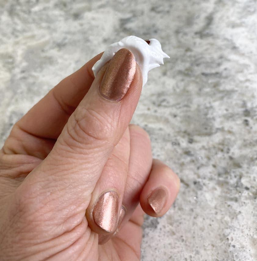 testing meringue between fingertips