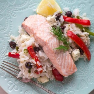 Greek salmon on decorative light white plate on white quartz