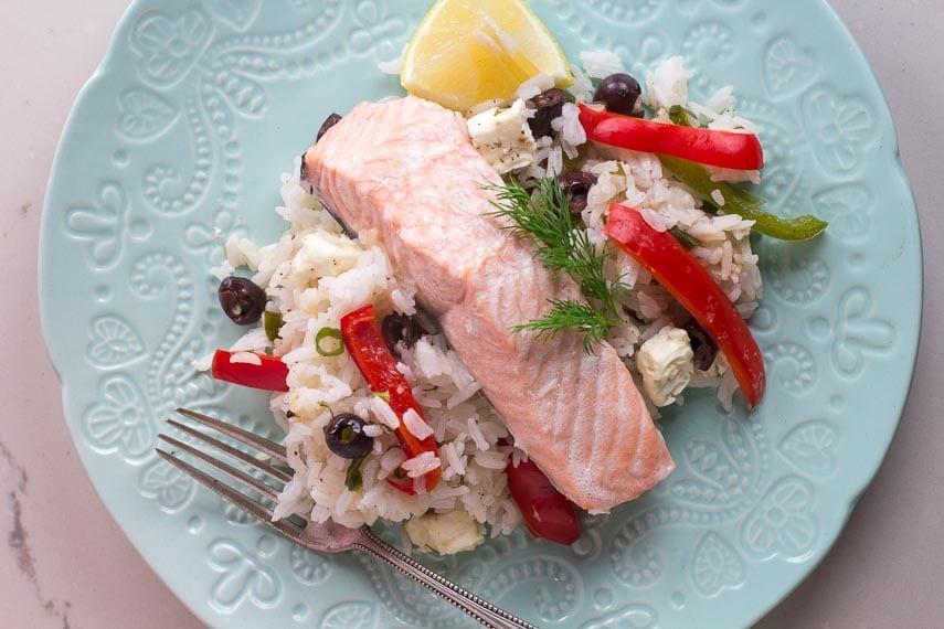 Greek salmon on decorative light white plate on white quartz