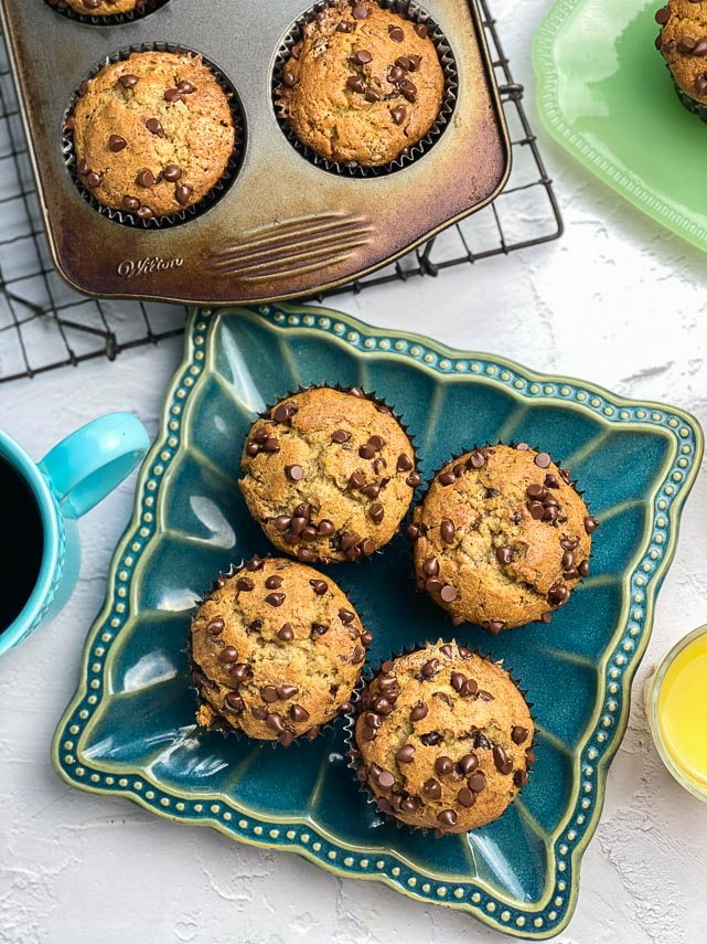 Low FODMAP Banana Chocolate Chip Muffins on a blue plate and in pan