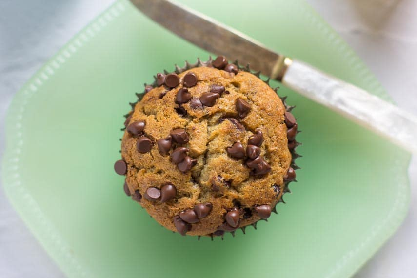 Low FODMAP Banana Chocolate Chip Muffins on a green plate