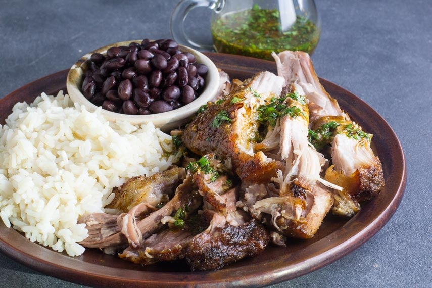 Low FODMAP Cuban Style Roast Pork with extra mojo in background