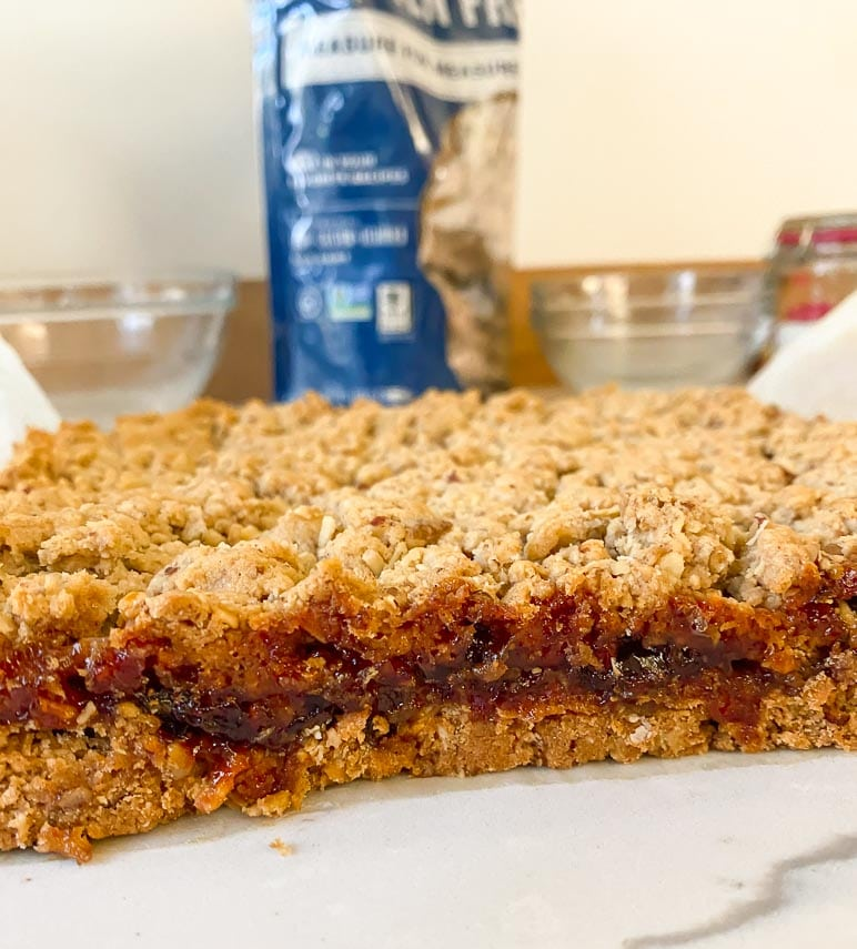 a look at the side of our unmolded Nutty Low FODMAP Strawberry Oat Bars