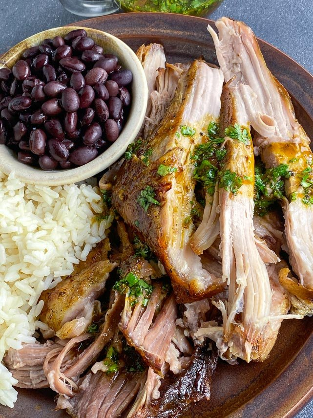 closeup image of Low FODMAP Cuban-Style Roast Pork with beans and rice
