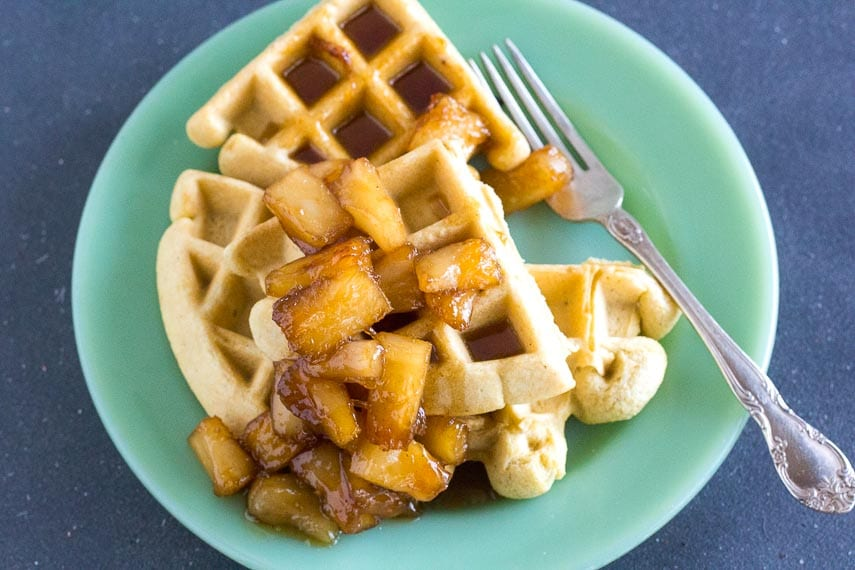 low FODMAP Caramelized Pineapple sauce on waffles and green plate and silver fork
