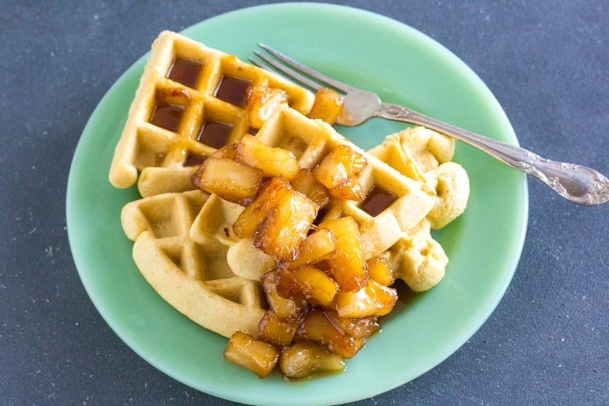 low FODMAP Caramelized Pineapple sauce on waffles and green plate