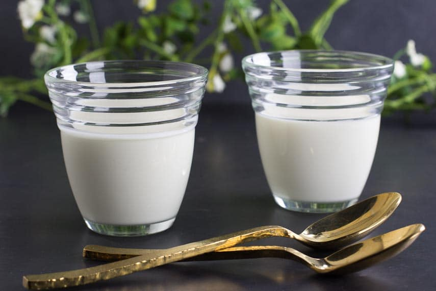 low FODMAP buttermilk panna cotta with gold spoons