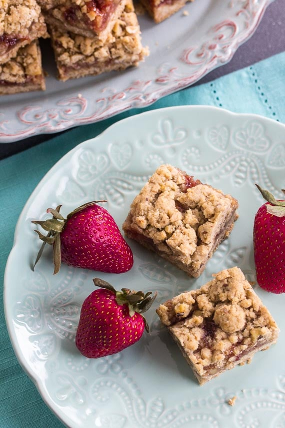 overhead vertical for Nutty Low FODMAP Strawberry Oat Bars on aqua plate