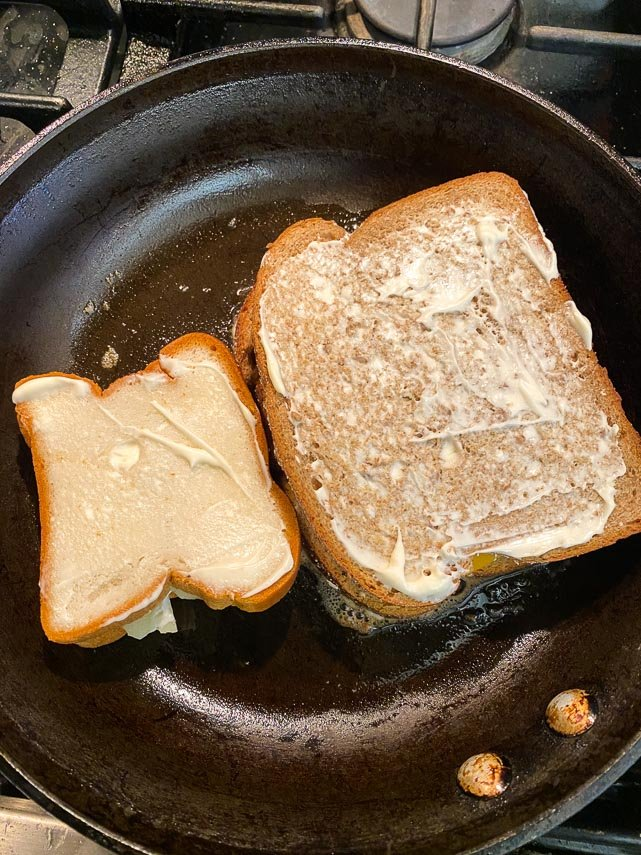 sandwiches in the pan, spread with mayo