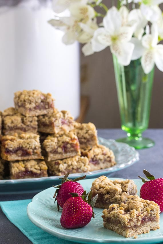 vertical for Nutty Low FODMAP Strawberry Oat Bars on aqua plate