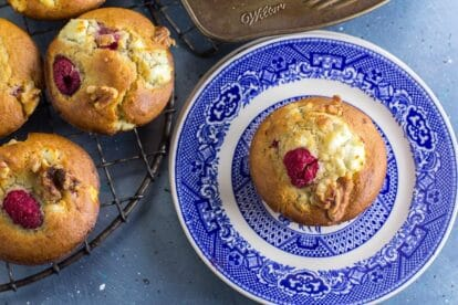 Main image of Low FODMAP Olive Oil Muffins with Goat Cheese, Walnuts and Raspberries; blue backdrop and blue plate