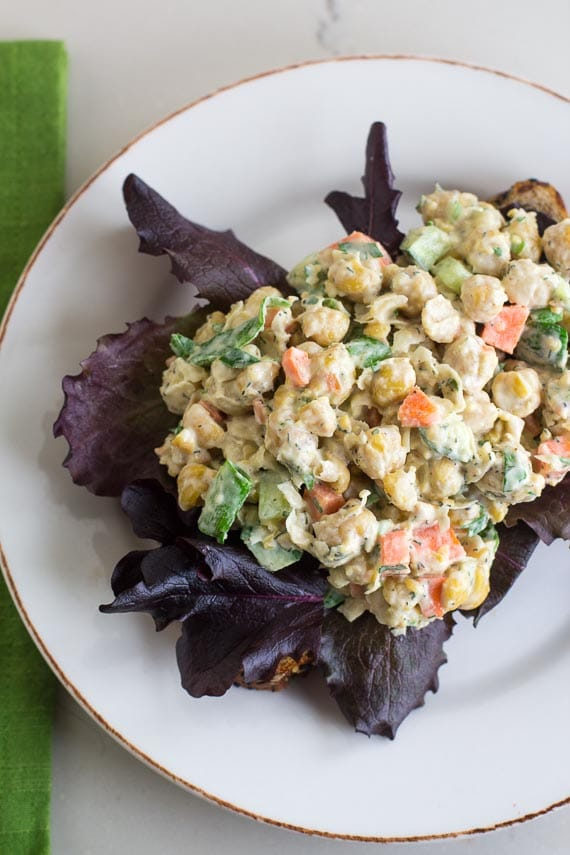 Overhead image of vegan low FODMAP CHICKPEA Salad as an open-faced sandwich on LOFO bread; green napkin