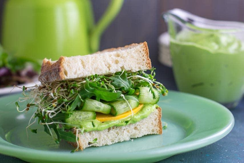 VEGAN Low FODMAP Avocado Green Goddess Veggie Sandwich on green plate