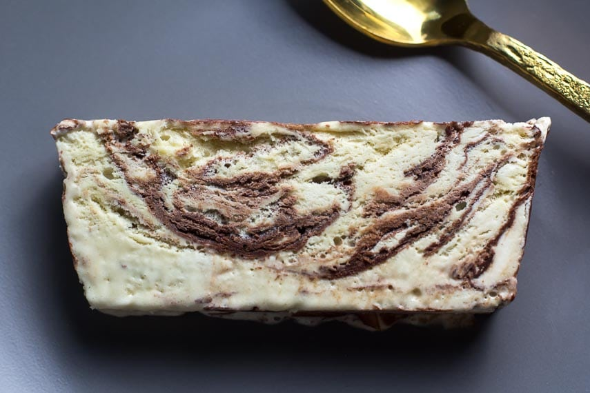 close up slice of Stracciatella low FODMAP Semifreddo, loaf shape, once slice flat on plate