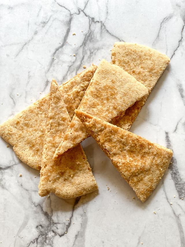 low FODMAP shortbread wedges on marble surface