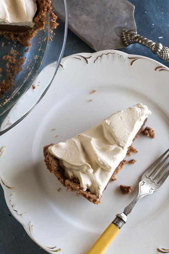 overhead image of wedge of Low FODMAP Black Bottom Pie on white plate with antique fork