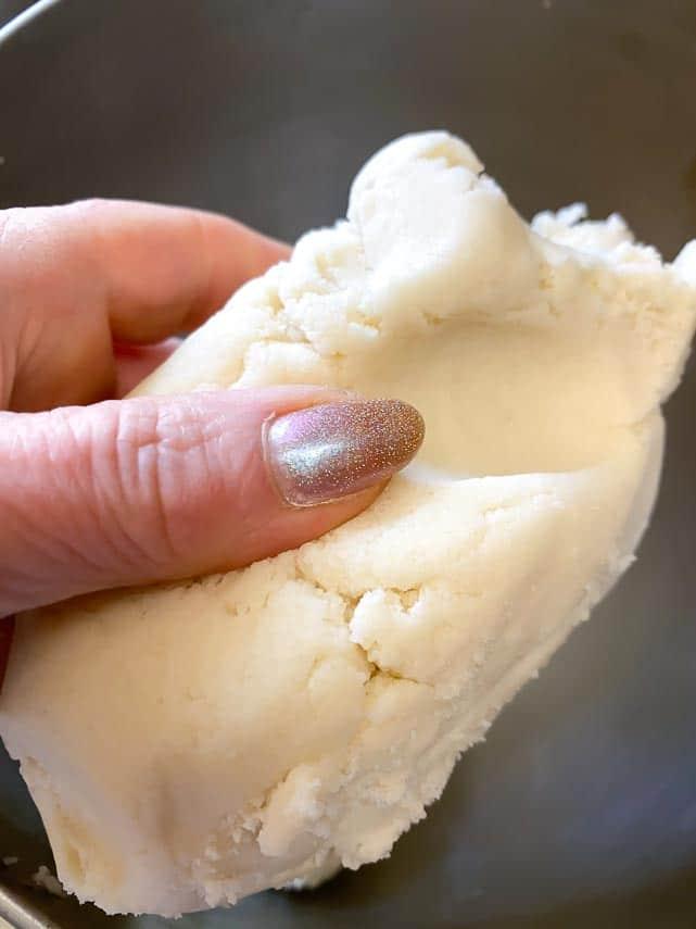 texture of low FODMAP shortbread dough held in hand