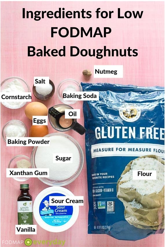 Ingredients for baked doughnuts on pink background