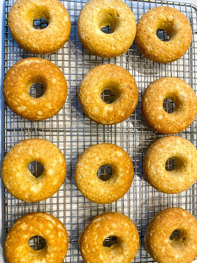 Low FODMAP Baked doughnuts on a rack