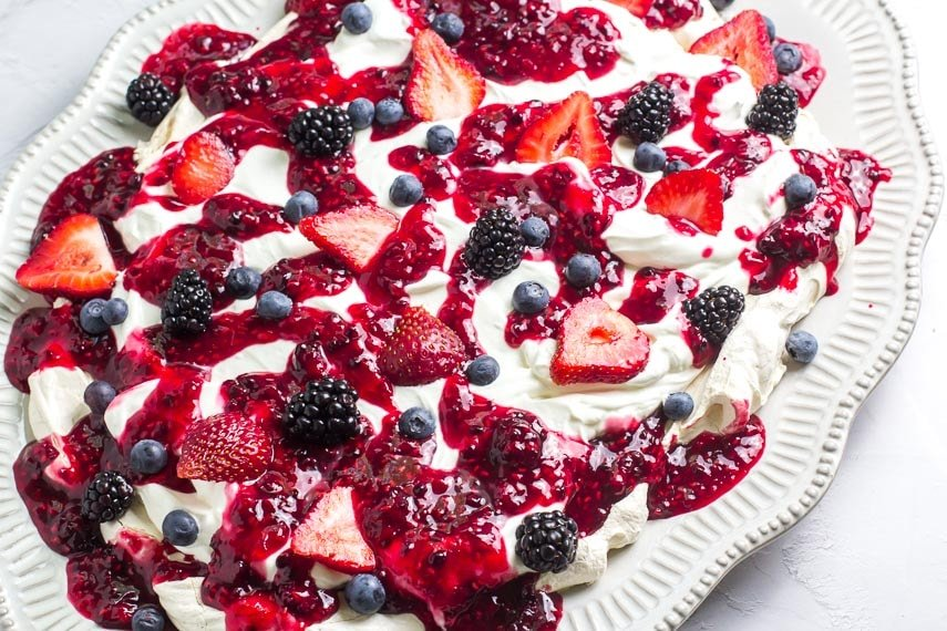 Main image of low FODMAP Mixed Berry Slab Pavlova on oval plate; white background