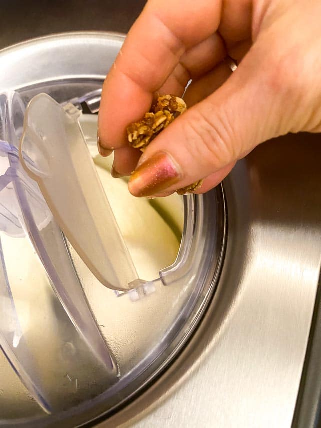 adding oat crunchies to churning ice cream