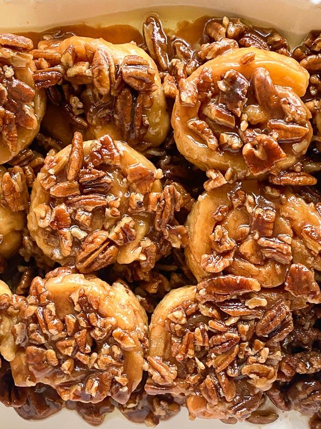 closeup of low FODMAP gluten-free caramel pecan sticky buns on white platter-2