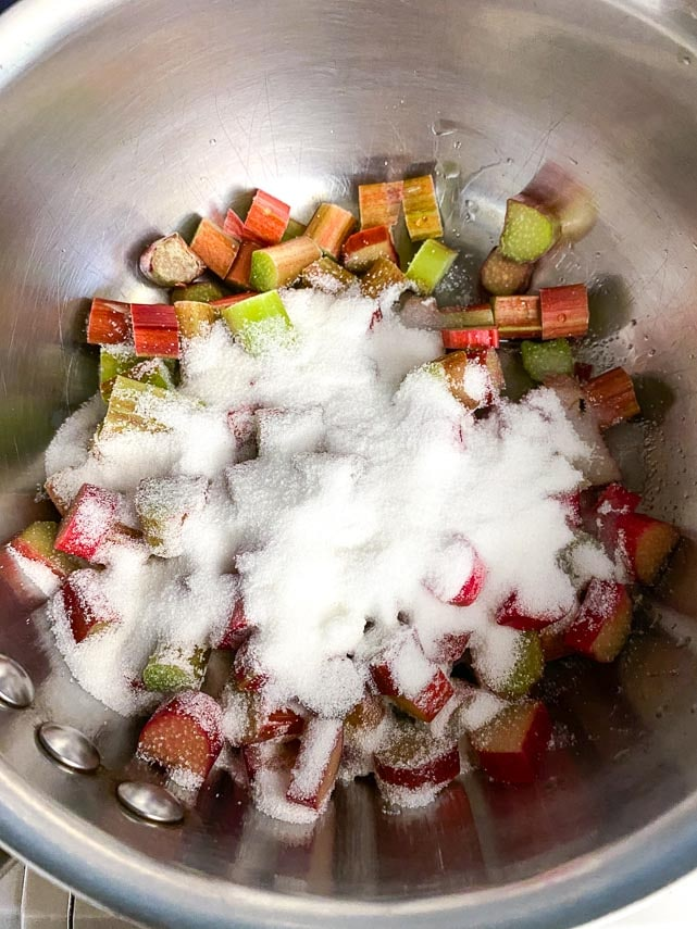 combining sugar and rhubarb in a pot for ice cream ripple