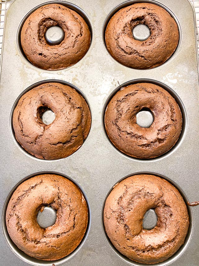 low FODMAP Baked chocolate doughnuts finsihed baking, in pan and cooling