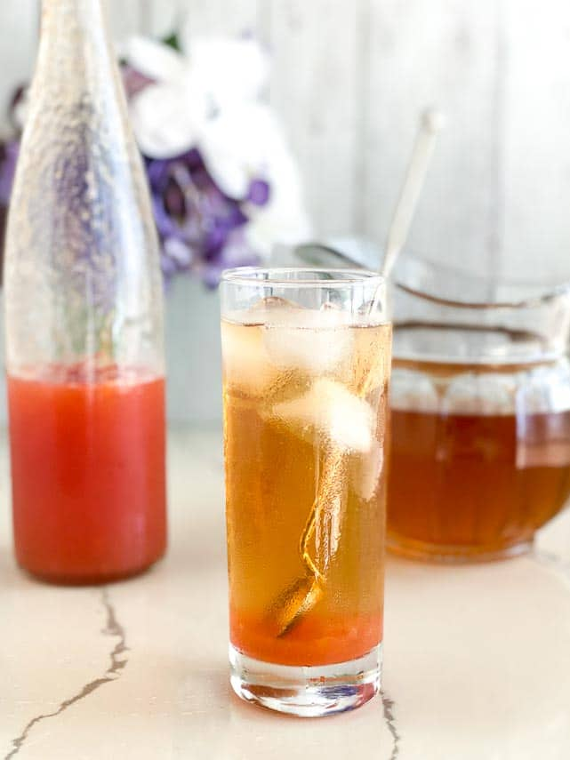 peach iced tea in a glass, not yet stirred up