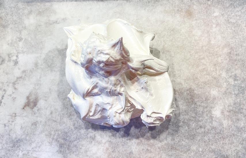 scrape meringue out on prepared pan