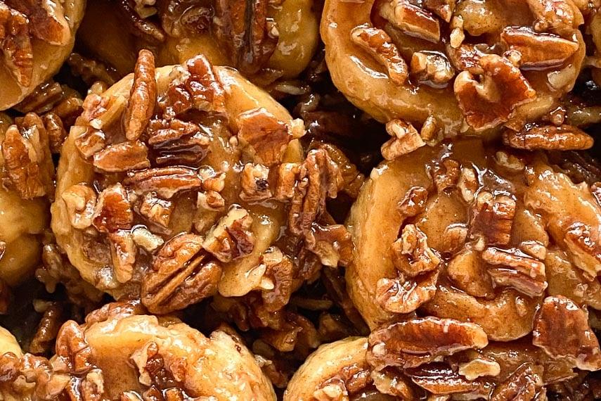 super closeup of low FODMAP gluten-free caramel pecan sticky buns on white platter-2