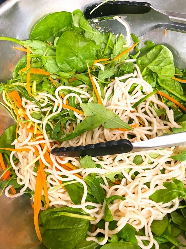tossing ingredients together for Thai Basil Steak Salad