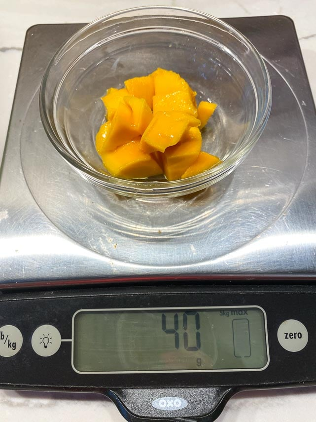 40 g of mango on scale in small dish
