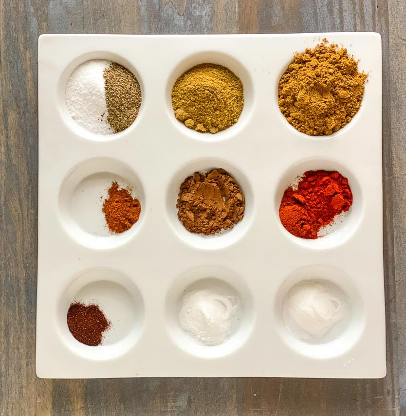 Low FODMAP Cumin Allspice Dry Rub ingredients in dish with separate indentations