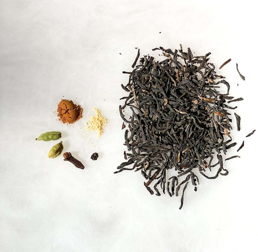Masala Chai Spices on white board with loose tea