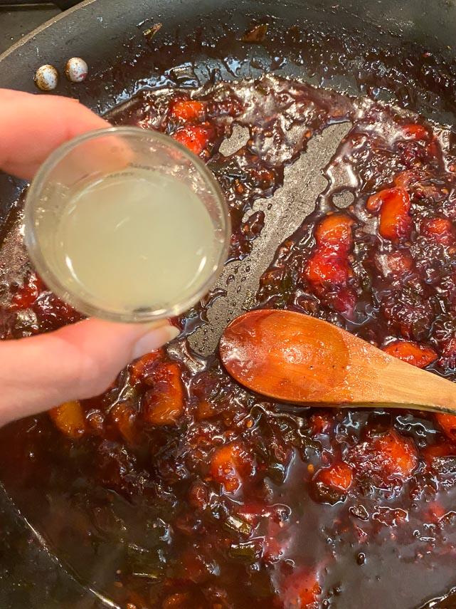 adding lemon juice to chutney as it finishes cooking