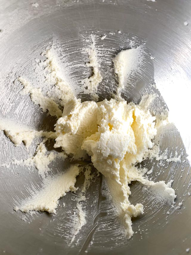 creaming butter and sugar in stand mixer bowl