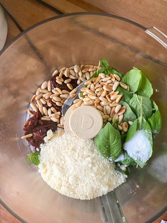 ingredients for low FODMAP sundried tomato pesto in bowl of food processor
